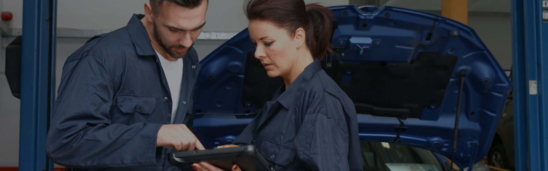 Auto Technicians Looking at iPad
